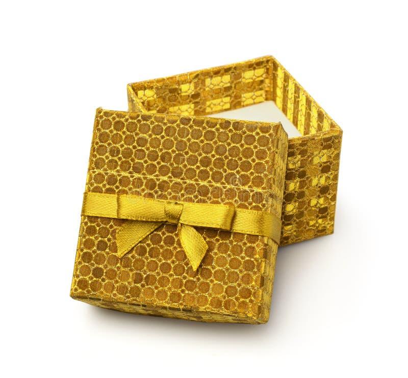 Ouvrez le cadre de cadeau d'or photos libres de droits