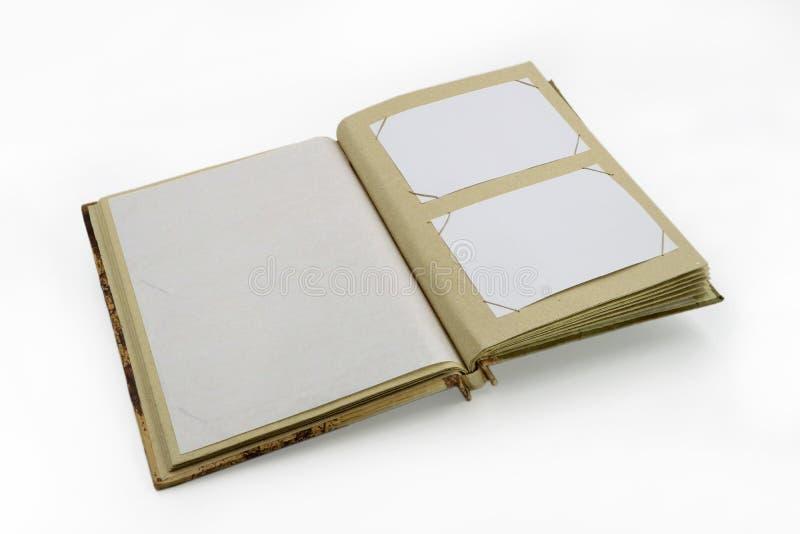 Ouvrez le livre d'album photos de journal intime ou sur le fond blanc photographie stock