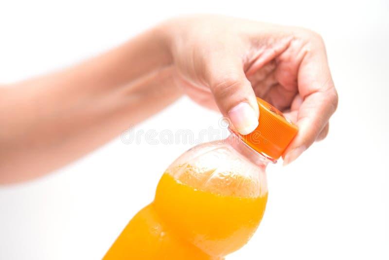 Ouvrez les capsules du jus d'orange photographie stock libre de droits