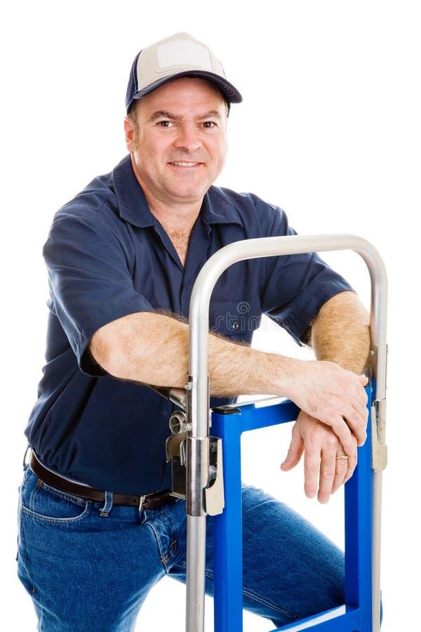 Ouvrier amical avec le chariot photos libres de droits