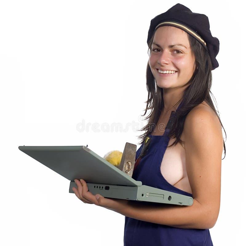 Ouvrier avec l'ordinateur portatif image libre de droits