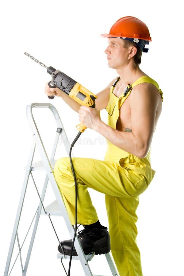 Ouvrier avec le foret photos stock