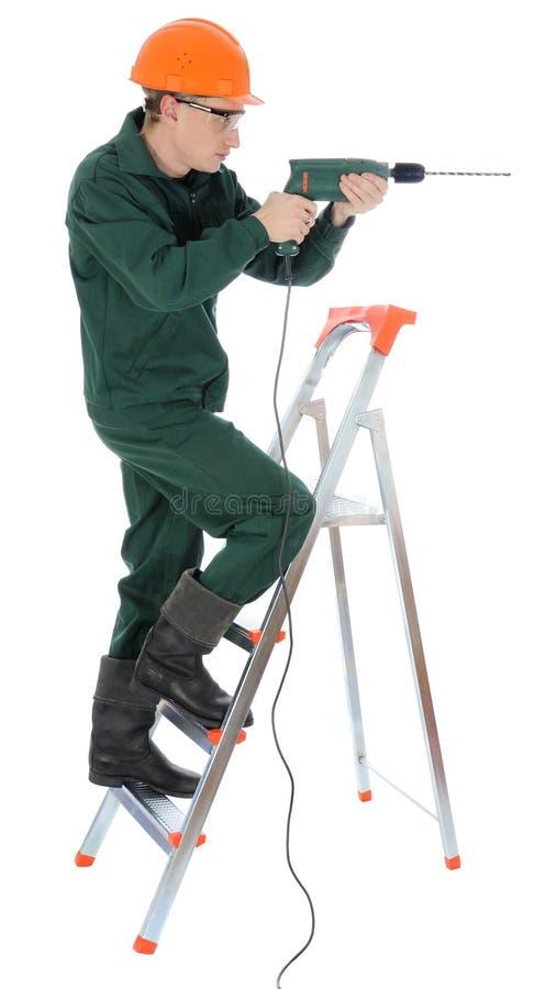 Ouvrier avec le foret photo libre de droits