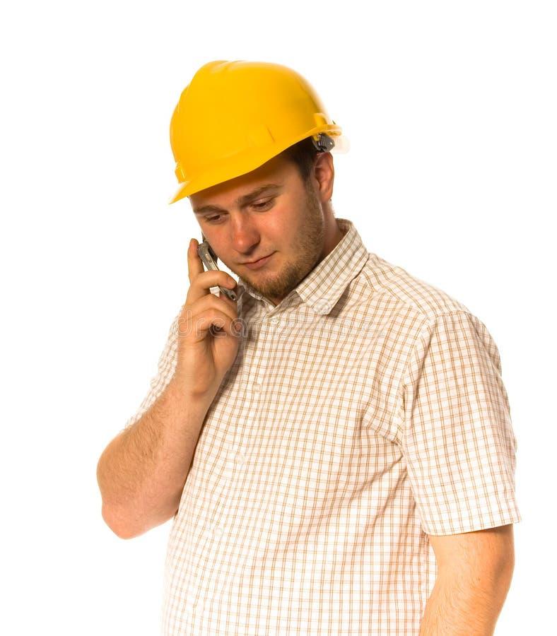 Ouvrier avec le téléphone photo stock