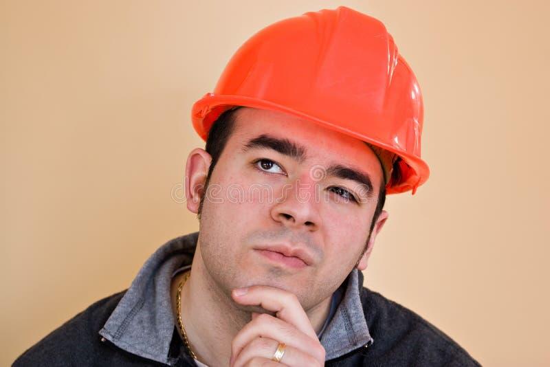 Ouvrier contemplatif photo stock
