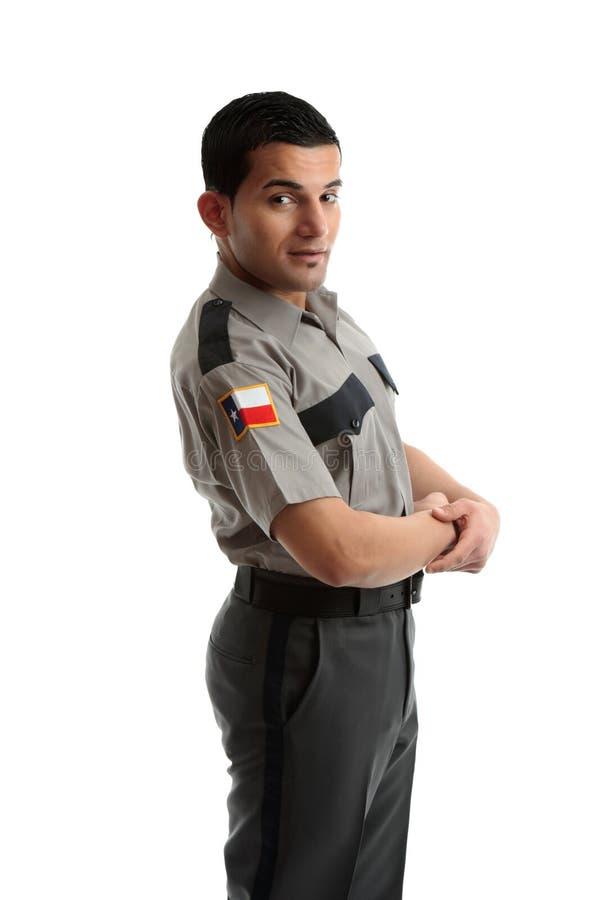 Ouvrier de sexe masculin dans l'uniforme restant de côté photographie stock