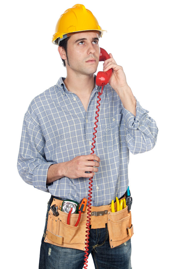 Ouvrier parlant au téléphone image stock