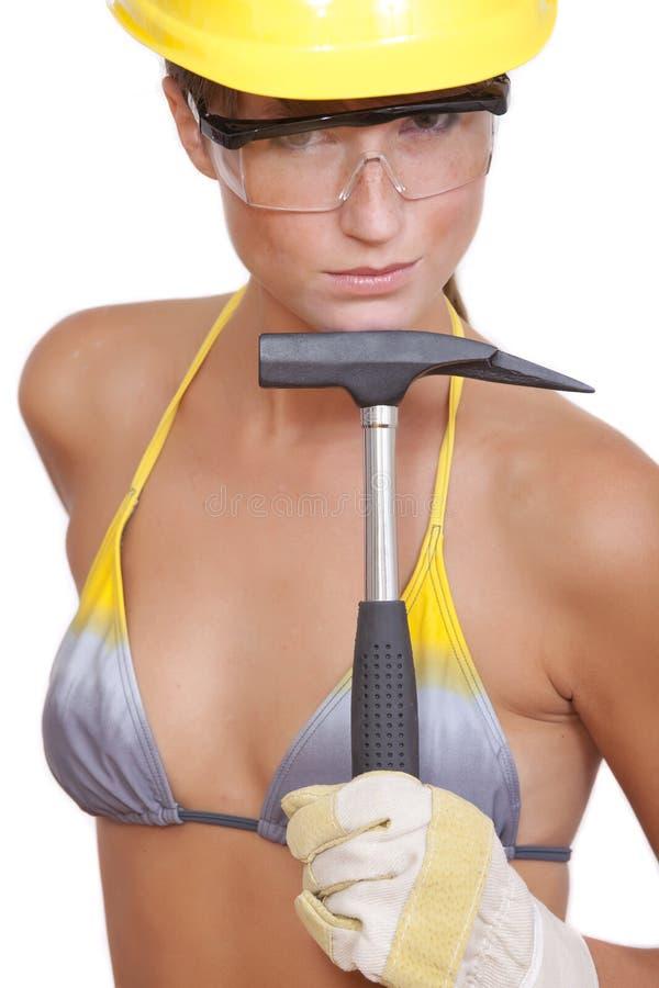 Ouvrier sexy avec le marteau photographie stock