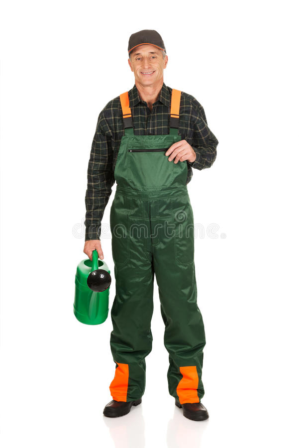 Ouvrier tenant la boîte d'arrosage verte image libre de droits