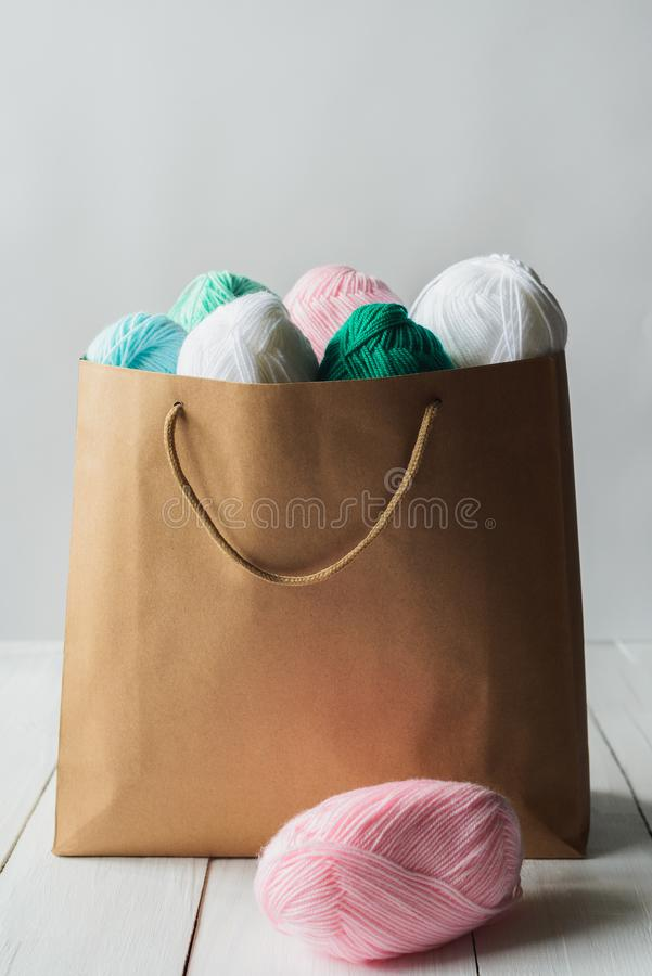Oval acrylic wool yarn thread skeins with kraft package stock image