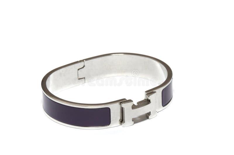 An oval ellipse stainless steel latch locking purple bracelet bangle royalty free stock photography