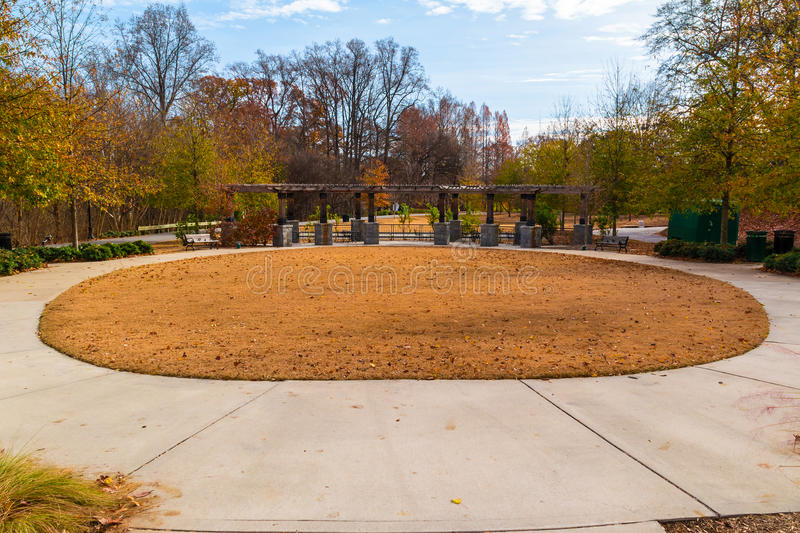 Oval lawn and Leaders Grove Arbor in Piedmont Park, Atlanta. Oval lawn with dry grass and Leaders Grove Arbor in the Piedmont Park in sunny autumn day, Atlanta stock photo