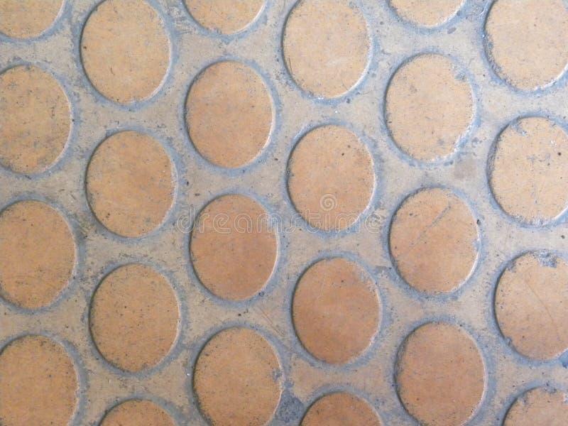 Oval shape beige floor tile background. Oval shape beige color floor concrete seamless tile background royalty free stock photography