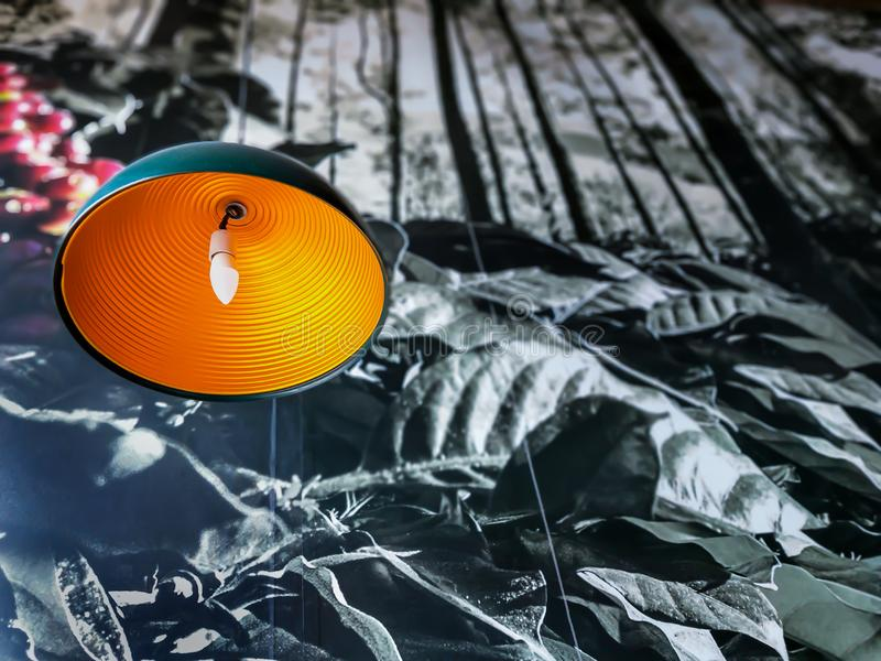 Oval shape hanging light in a coffee shop. Beautiful oval shape hanging light in Cafe coffee  Day with orange stripes royalty free stock image