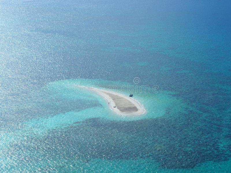 Oval White Sand Island at Daytime royalty free stock photo