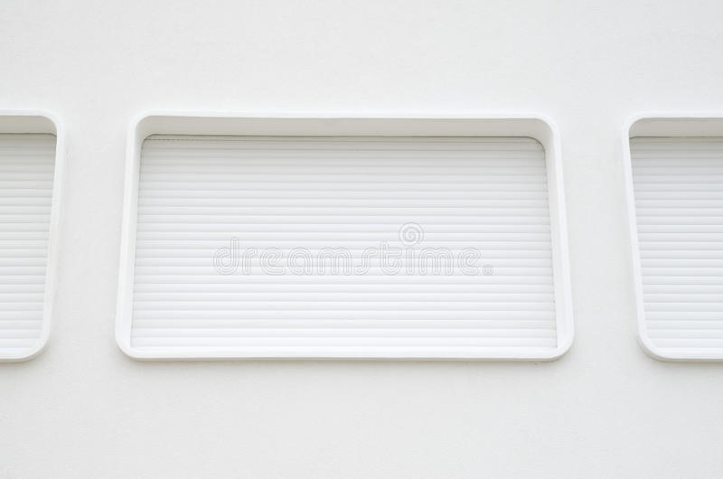 Oval windows with new white external blinds stock photos