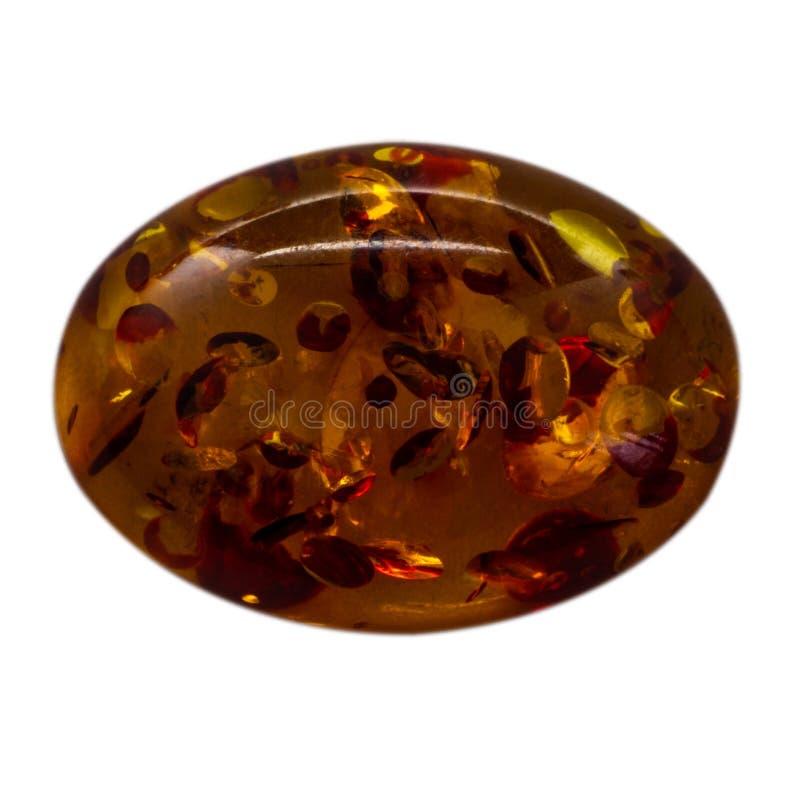 Ovale cabochon van glanzende kunstmatige ambermacro royalty-vrije stock fotografie
