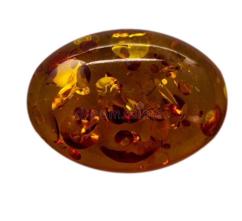 Ovale cabochon van glanzende kunstmatige ambermacro royalty-vrije stock afbeelding