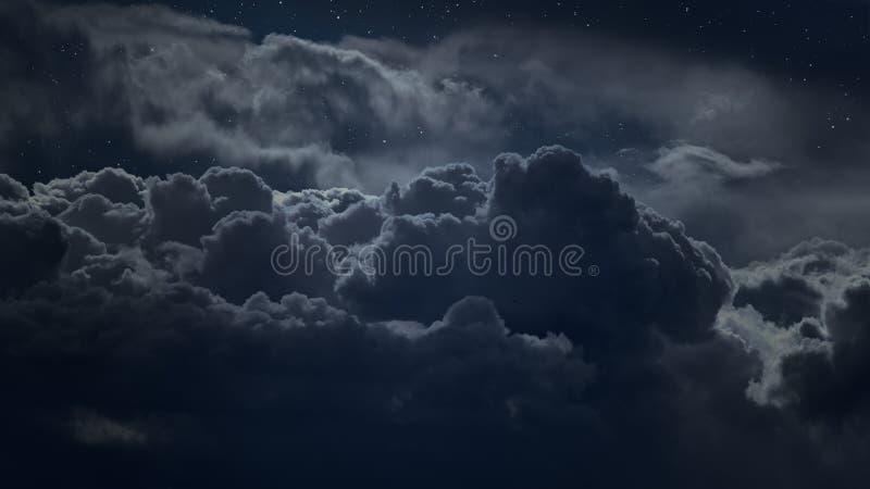 Ovanför molnen på natten arkivbild