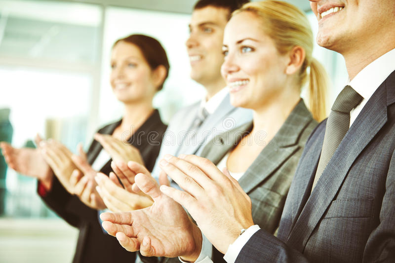 Ovation to speaker. Business people clapping at conference stock photos