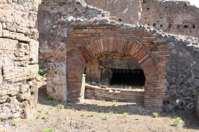 Pompeii Roman oven in Italy. Oven in ancient ruins of Pompeii destroyed by volcanic eruption of Vesuvius in AD 79 stock photo