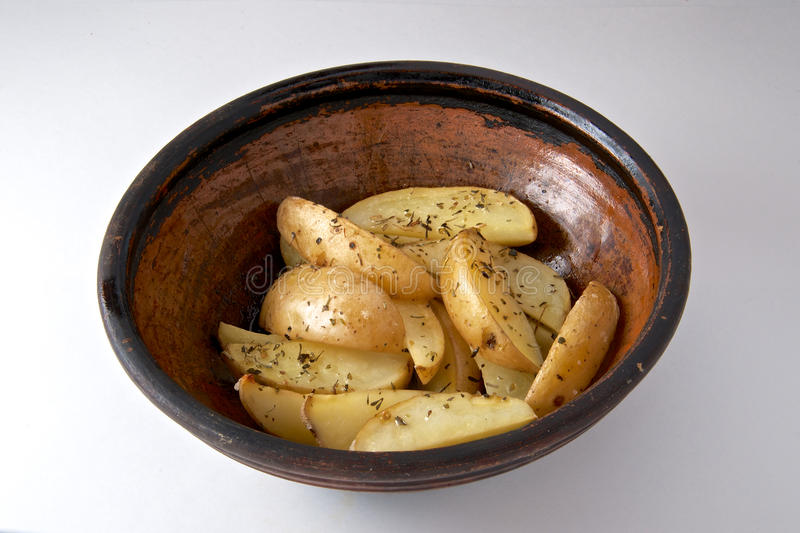 Oven baked potato with rosemary stock photos