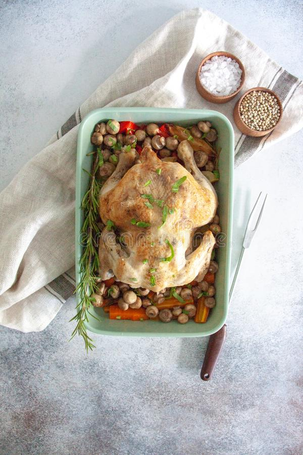 Oven bakes chicken with veggies and mushrooms stock photography