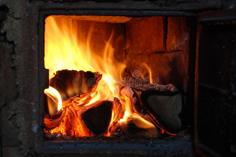 In an oven burning birch firewood stock photo