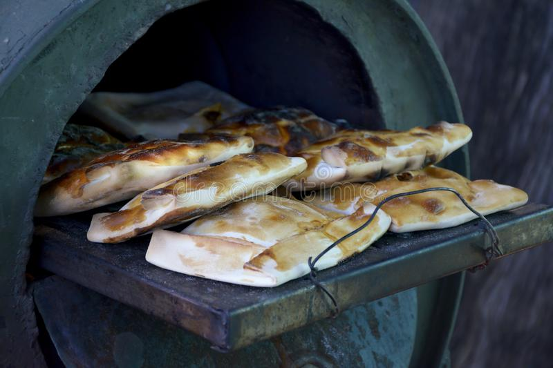 Meat pies in the oven door. royalty free stock images
