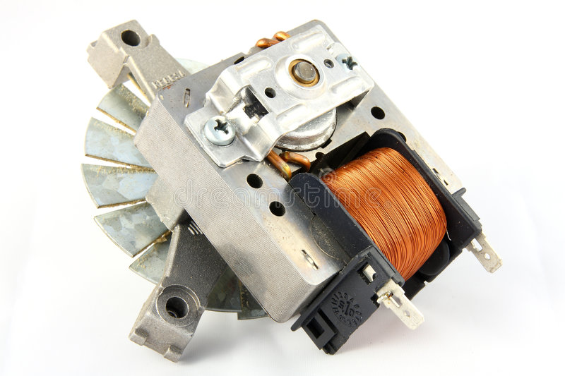 Oven Fan Motor. The motor from an electric fan oven showing the inductor, magnet laminations, bearings, cooling fan and connectors royalty free stock photos