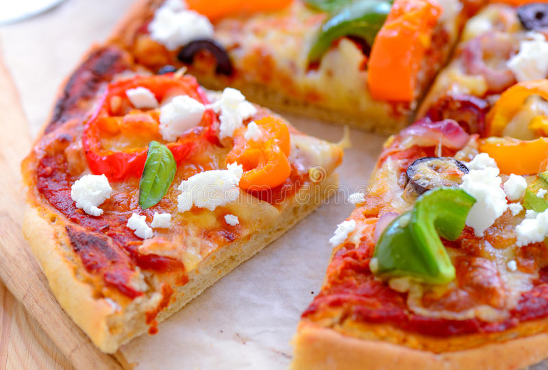 Oven fresh Pizza slices royalty free stock photography