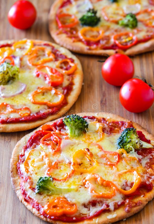 Oven fresh vegetarian Pizzas royalty free stock image