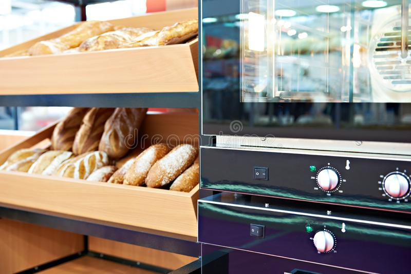 Oven and loaves of bread on shelf stock photography