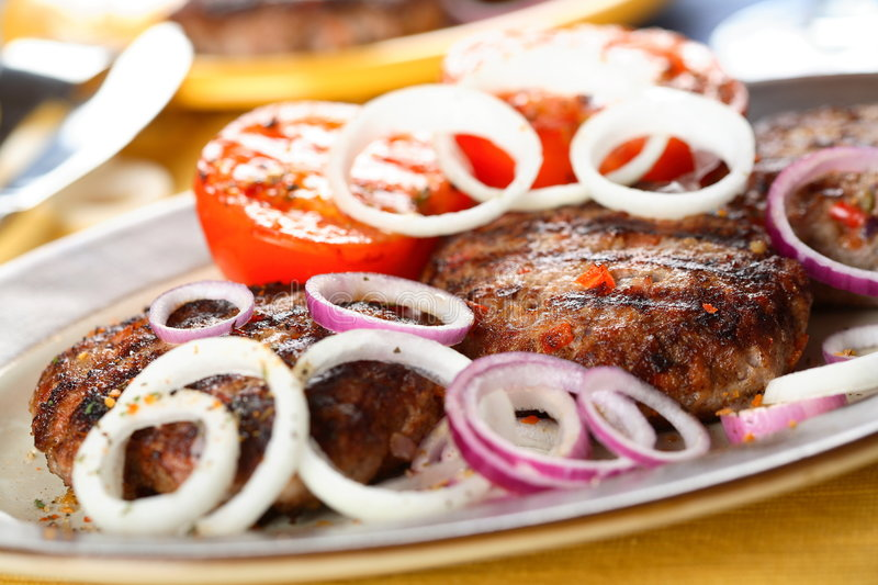 Oven meat with onion royalty free stock photo