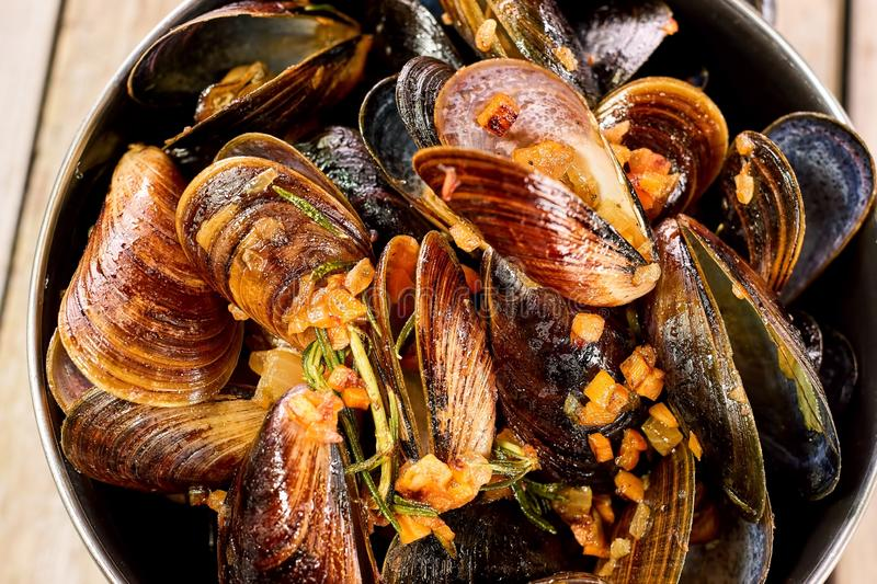 Oven-steamed mussels top view, close up. stock photos