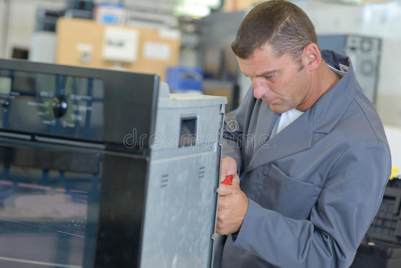 Oven technician doing work royalty free stock image