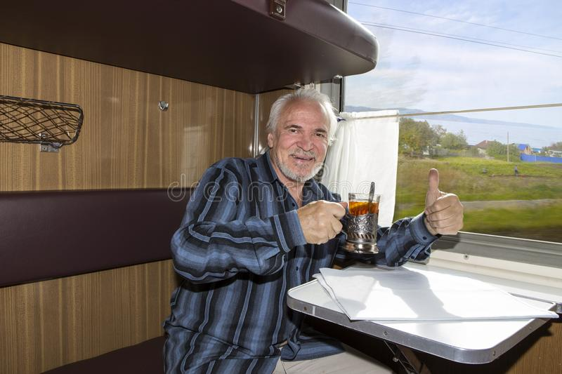 Over a cup of tea on the train stock photography