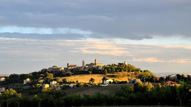 Over the hills and far away. Shot taken during a stroll on the hills of Marche, an Italian region. The town on the top of the hill is Montecosaro royalty free stock photography