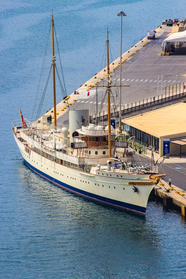 Over looking the Grand Harbour, Valletta, Malta, a classic and beautiful vintage yacht royalty free stock photo