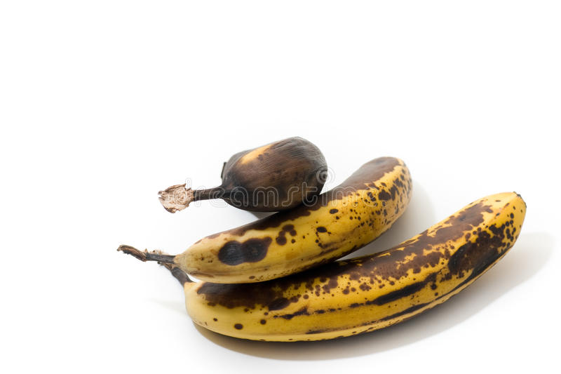 Over-ripened bananas, isolated stock image