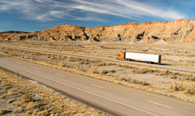 Over The Road Long Haul 18 Wheeler Big Rig Truck. A trucker navigates this Utah highway in his big rig stock photography