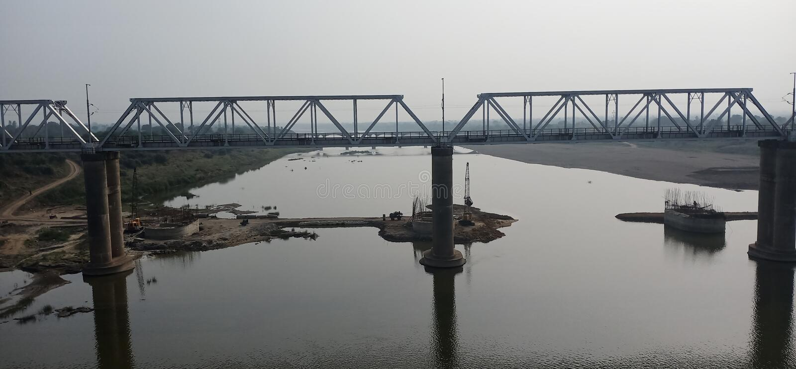 Over seeing the bridge and ever while journey in the train is some time memorable and eyes catching picture that gives us energy. Over seeing the bridge and stock images