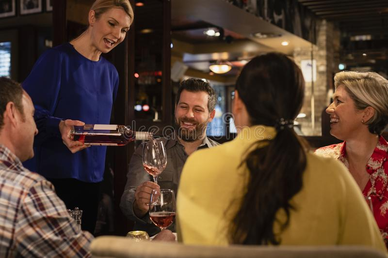 Waitress Pouring a Glass of Wine royalty free stock photos