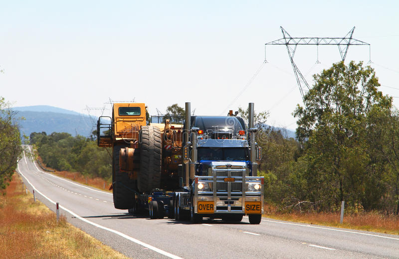Over Size truck load. An Australian truck with over size load, taking up the Whole road stock image