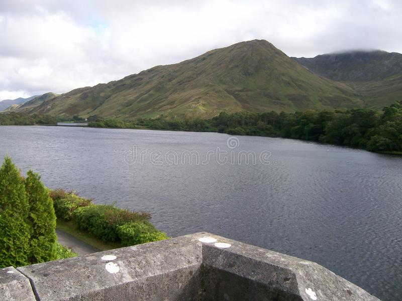 Over the Wall. View from an Irish castle showing beautiful mountains and lakes stock photos