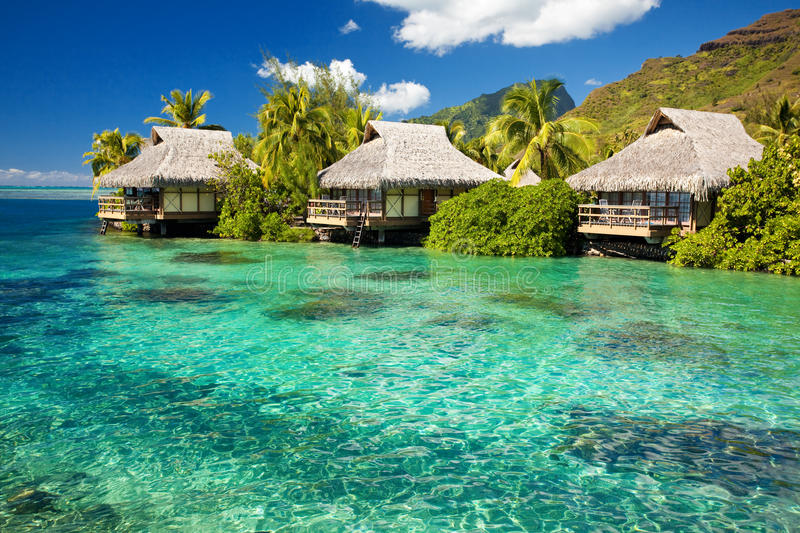 Over water bungalow with steps into amazing lagoon. Over water bungalows with steps into amazing green lagoon stock photography