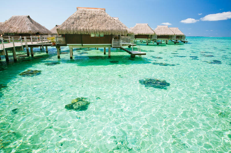 Over water bungalow with steps into amazing lagoon stock image
