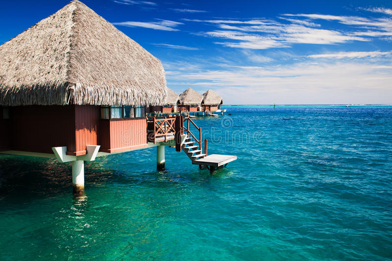 Over Water Bungalow With Steps Into Clear Ocean Stock