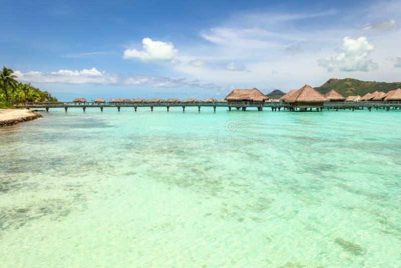 Over water bungalows into amazing green lagoon at Bora Bora island stock photos
