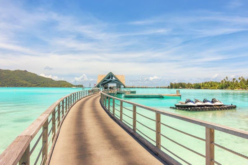 Over water bungalows into amazing green lagoon at Bora Bora island stock image